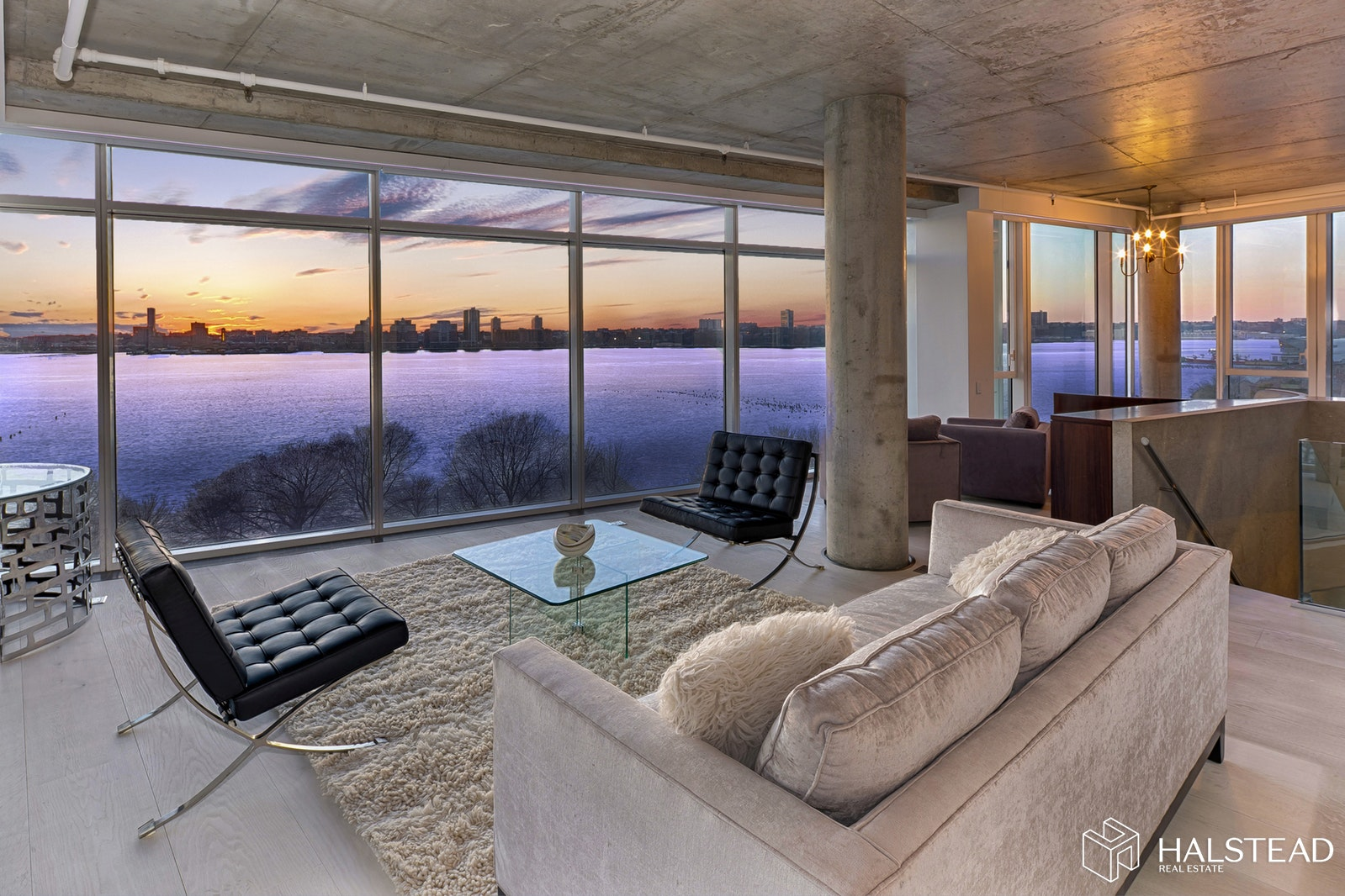 The breathtaking unobstructed Hudson River view of the Freedom Tower and downtown is just one aspect of this truly unique and gorgeous duplex apartment. Close to 3700 sqft, this eye-catching 3-bedroom home includes a Grand Master Bedroom that enjoys all the views of the living space, 3 private balconies, 3.5 bathrooms, a media room, home office area, laundry with a double washer/dryer, plenty of storage, multi zoned central air and heat, a stunning chef's kitchen and an elevator that opens into your home on both floors. The 10-foot-high ceilings and floor to ceiling glass walls make this modern duplex so special. Other features include custom built wine closet, white oak plank flooring, beautiful cabinetry and a stylish stone staircase connecting the two floors. 173 Perry is a full service condominium with a brand new gym and renovated building utilities.