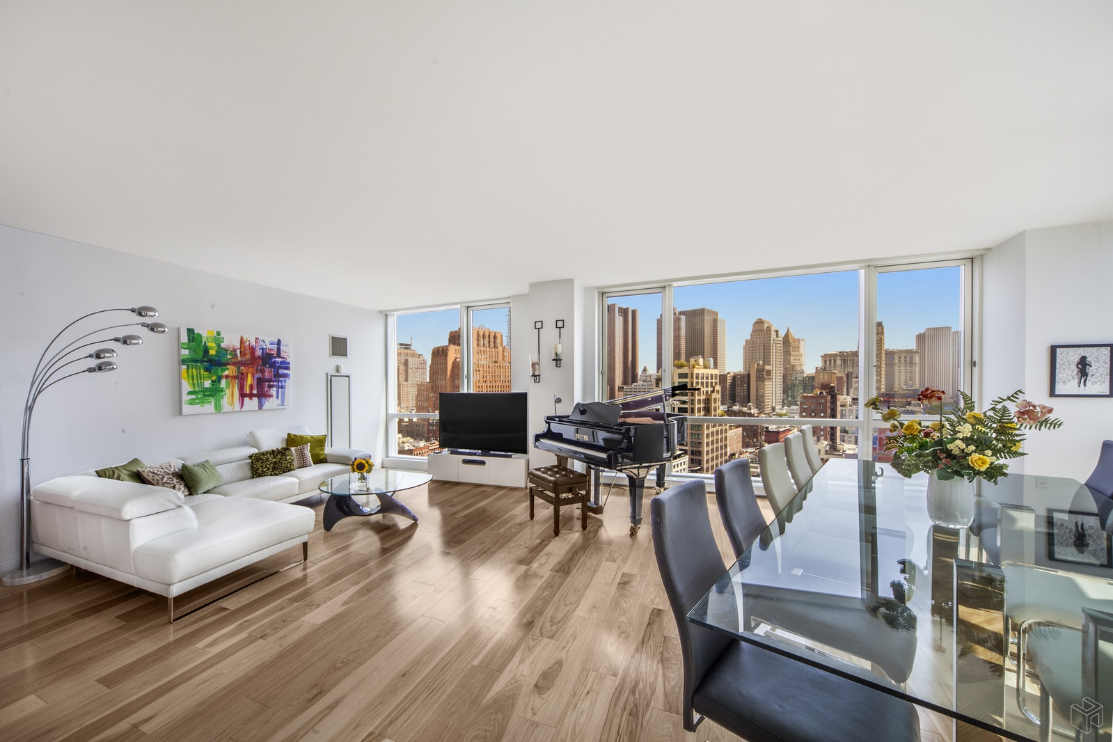 """This wondrous two bedroom, two and a half bathroom condominium home floats high in the sky over Tribeca and has over $100,000 in upgrades - new kitchen and floors. One enters the incredibly spacious living/dining room which has floor-to-ceiling windows, bringing in incredible light all day with open East and South City views. The open kitchen has tremendous storage and was completely renovated in 2017 with custom Hans Krug cabinetry, quartzite countertops, Miele stainless steel appliances, a vented stove-top and a Subzero refrigerator. The roomy master king-sized bedroom has a luxurious marble master bathroom with double sinks on marble countertops, a deep soaking tub and a separate walk-in shower. The second bedroom also has an en suite bathroom and both bedrooms feature floor-to-ceiling windows with gorgeous open Eastern views. There is a half bathroom in the bedroom wing with a brand new Bosch washer/dryer. The floors throughout the apartment are 6.5"""" Hickory in a natural color and were installed in 2017. Other apartment features include central heat and air conditioning and all rooms have floor-to-ceiling windows. 200 Chambers is a luxury condominium with a 24 hour doorman, concierge and wonderful building amenities. The double-height ceiling lobby is bright and welcoming and features a planted courtyard. There is a spectacular roof terrace on the 8th floor with multiple seating areas and River and City views. There is also a gym, a sky-lit pool, a playroom and a resident's lounge. There is a garage in the building (separate fee) that is directly accessible through the building. The location cannot be beat - close to Whole Foods, Bed Bath and Beyond, Hudson River Park, Le District, major subways, the PATH train and a wonderful variety of world class restaurants. NO PETS and NO SMOKERS."""