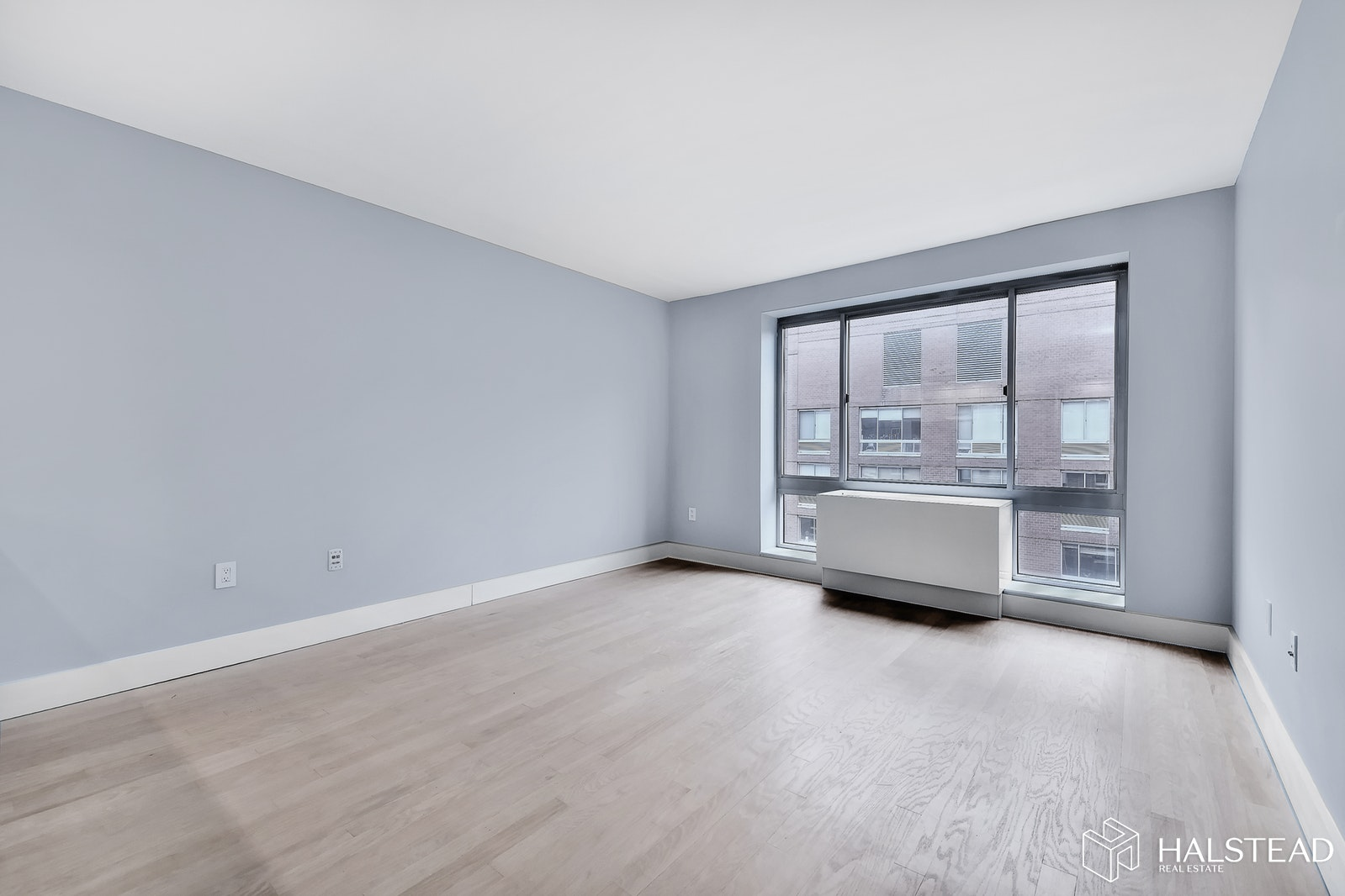 NO BROKER FEE - Available only through summer of 2021. One of the largest 1BR units in the building at 706' & one of the very few that's been completely renovated and is available to rent now. Wonderful northern views over the courtyard and of the Hudson Yards, Empire State and tons of direct sunlight. There's an entrance to the famous High-Line Park on the corner. Privacy assured as there's no other neighbor adjoining the bedroom. Top-of-the-line appliances including Miele and Bosch stove/convection oven, a fully redone bathroom, in-unit W/D, and custom counter/breakfast bar are all special touches that set this apt apart from the run of the mill 1BRs in the building. The building has a 2000' gym, 10,000' residents' courtyard, a residents' lounge with pool table and kitchen, on-site garage, bike storage & F/T DRMN & Super.. No Pets or Smokers. Available ASAP.