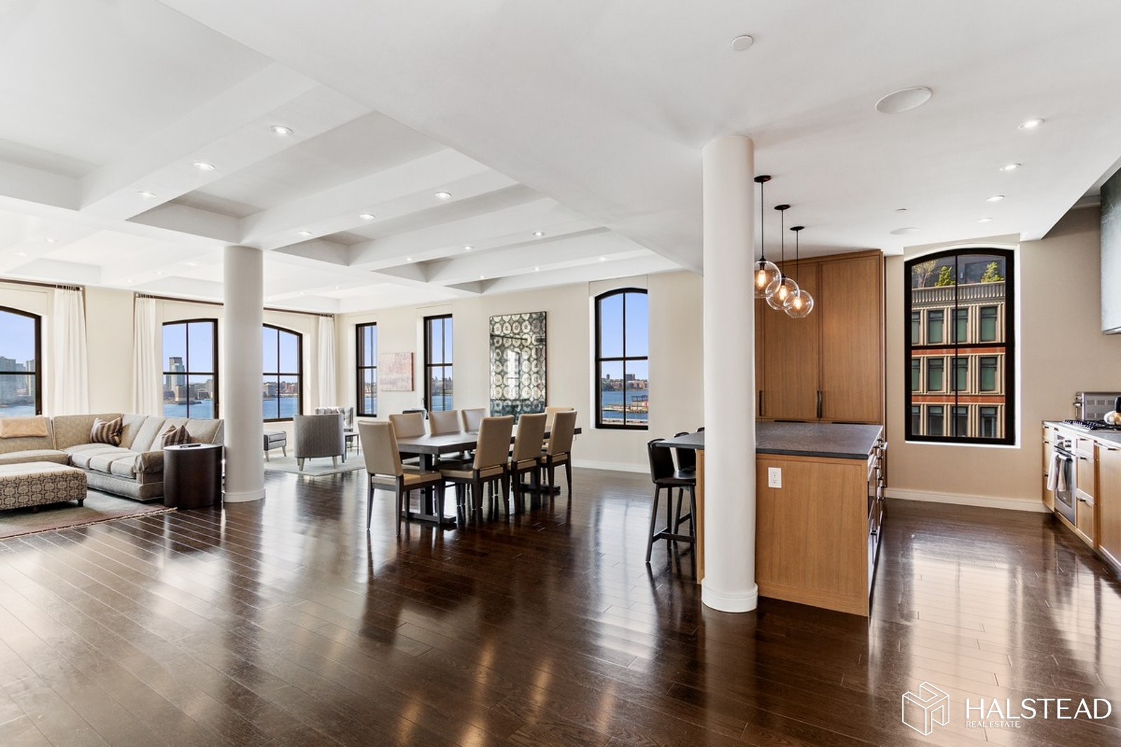 This stunning residence is perched high above the Hudson River and features a sun-drenched Living/Dining room with high ceilings, gorgeous wide-plank flooring, and spectacular sunset views from a wall of enormous picture windows. The state-of-the-art chef's kitchen with center-island is open to the entertaining space and features custom Poggenphol cabinetry and top-of-the-line Bosch and Subzero appliances. At one end of this magnificent home, you'll find the sumptuous Master Bedroom suite, a light-filled sanctuary facing the Hudson River offering a massive walk-in closet and a gorgeous 5-fixture en-suite bathroom replete with glass-enclosed rain shower and deep soaking tub. At the opposite end of the home, a long hallway separates public from private and leads to 4 generous-sized guest bedrooms, a large Media room, and a Den/Playroom. Additional amenities include multi-zoned central air-conditioning, a separate laundry room, abundant storage space, and a tasteful powder room for guests. All this, in TriBeCa's condominium conversion featuring a 24-hour doorman, live-in superintendent, dramatic lobby with separate library, state-of-the-art fitness center, 61-foot indoor lap pool, children's playroom, and spectacular roof top garden with panoramic city and river views. Enjoy absolute luxury right across from the Hudson Waterfront Park!
