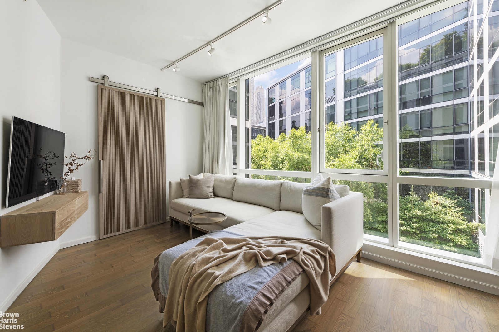 Welcome home to residence 3U at 200 Chambers Street. This large one bedroom home is located in a prime full service Tribeca condo and features hardwood floors throughout, high ceilings and floor-to-ceiling windows that run the entire length of the apartment and allow for beautiful natural light and tree-top views of the building's perfectly manicured garden. 3U at 200 Chambers Street is ideally situated with a bright southern exposure looking out onto the landscaped garden, which also ensures a pin-drop quiet environment. Residence 3U includes two large walk-in-closets and an additional closet for all of your storage needs. The kitchen is outfitted with Basaltina lava stone countertops and premium stainless steel appliances from Viking, Subzero and Bosch. The bathroom features sleek custom cabinetry and calacatta marble tiling paired with premium fixtures and fittings. Amenities at 200 Chambers Street include: a 24 hour doorman, concierge services, 24 hour fitness center, sky-lit indoor pool, laundry on every floor, resident's lounge, a landscaped roof-top terrace, children's playroom and a waterfall courtyard garden. 200 Chambers Street provides convenient access to the very best of Tribeca including Whole Foods, Soul Cycle, The Palm Steakhouse and much more! Located across the street from beautiful Washington Market Park and the Wednesday Green Market, and minutes from some of Tribeca's finest shops and restaurants and the Hudson River Esplanade, 200 Chambers Street is ideally situated in the heart of Tribeca.