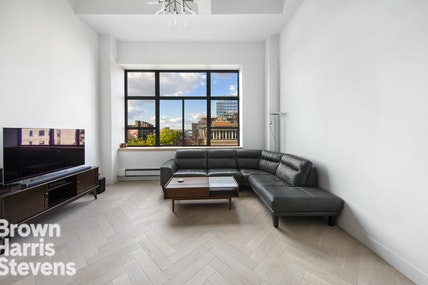 Welcome to this renovated lofted one-bedroom in the heart of the West Village with absolutely stunning Hudson River views. As you enter the home, you are greeted by gorgeous herringbone wood floors throughout. In the foyer, you have a long entryway with a massive storage area spanning the full width of the apartment. Stepping into the great room, you have oversized west and north-facing windows with picturesque river views and some of the most beautiful sunsets you've ever seen. The ceilings are 14ft high giving the space an extremely open and airy feel throughout. The open concept kitchen is perfect for those that like to entertain and comes equipped with top of the line appliances. The staircase leads up to the bedroom. The bedroom loft has 8ft ceilings, a large closet, and a separate nook that can be used as a dressing room, home office, or exercise area.130 Barrow Street is a 96-unit condominium on a picturesque West Village street near the Hudson River. The building has a live-in superintendent, a daily porter on staff, glass-windowed elevators, a garden courtyard, professionally landscaped and furnished roof deck with panoramic views, and an amazing West Village location moments from the Hudson River Park, High Line, Meatpacking District, PATH and #1 subway lines, and hundreds of boutiques, eateries and more.